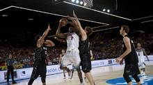 Kenneth Faried of the U.S, moves the ball in front New Zealand's Tai Webster, left, and Rob Loe during the Group C Basketball World Cup match, in Bilbao northern Spain, Tuesday, Sept. 2, 2014. (Alvaro Barrientos/AP)