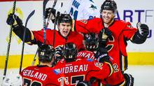 Calgary Flames players celebrate a goal by Micheal Ferland against the San Jose Sharks during the third period at Scotiabank Saddledome on Jan. 11, 2016. (Sergei Belski/USA Today Sports)