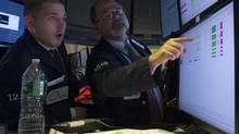 Traders work on the floor of the New York Stock Exchange June 26, 2014. (BRENDAN MCDERMID/REUTERS)