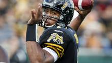 Hamilton Tiger-Cats quarterback Henry Burris throws a pass against the Edmonton Eskimos in the first half of their CFL game in Hamilton September 15, 2012. (FRED THORNHILL/REUTERS)