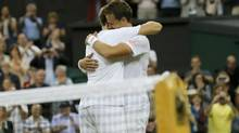 Vasek Pospisil of Canada and Jack Sock of the U.S. (L) celebrate defeating Bob Bryan of the U.S. and Mike Bryan of the U.S. in their men's doubles final tennis match at the Wimbledon Tennis Championships, in London July 5, 2014. (SUZANNE PLUNKETT/REUTERS)