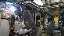 A welder works inside a commuter rail car being built for Long Island, N.Y. at the Bombardier Transport plant in La Pocatière, Que. Wednesday, Dec. 3, 2003. (JACQUES BOISSINOT/CP)