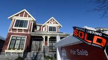 Home prices are greatly outpacing the median income in many Canadian cities, but the gap isn't as wide in Calgary. (Jonathan Hayward/THE CANADIAN PRESS)