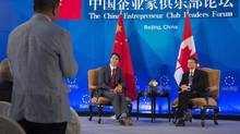 China Entrepreneur Club chairman Jack Ma (right) and Canadian Prime Minister Justin Trudeau listen to a member of the business community ask a question during an event in Beijing, China Tuesday August 30, 2016. (Adrian Wyld/THE CANADIAN PRESS)