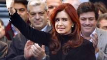 Argentina's President Cristina Fernandez de Kirchner waves during a rally in Buenos Aires, April 27, 2012. (Marcos Brindicci/REUTERS)