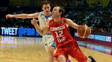 Brady Heslip (R) vies for the ball with Santiago Vidal (L) during their 2015 FIBA Americas Championship Men's Olympic qualifying match at the Sport Palace in Mexico City on September 7, 2015. (ALFREDO ESTRELLA/AFP/Getty Images)