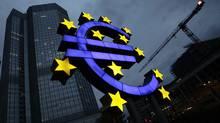The illuminated euro sign is seen in front of the headquarters of the European Central Bank (ECB) in Frankfurt April 5, 2011. (KAI PFAFFENBACH/KAI PFAFFENBACH/REUTERS)