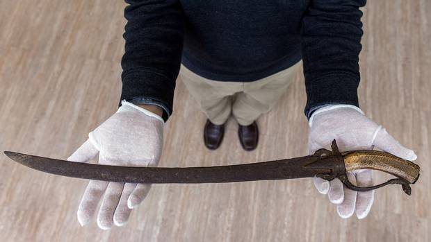 Dennis Oomen, curator the City of Penticton Museum, holds a Spanish sword that was discovered on the grounds of the O'Keefe Ranch in B.C.'s North Okanagan.