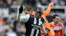 Newcastle United's Senegalese striker Demba Ba (front) vies with Swansea City's Mark Gower during their English FA Premier League football match at St James' Park, in Newcastle upon Tyne on December 17, 2011. (GRAHAM STUART/AFP/Getty Images)
