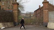 Beyond these historic barrack gates, which are to be spared, the decline of Shorncliffe in recent years is clearly visible. (Jim Ross for The Globe and Mail)