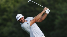 Dustin Johnson hits a shot into the 16th green at the Tour Championship in Atlanta on Thursday. Johnson has a share of the lead and six straight rounds of 68 or better. (Sam Greenwood/Getty Images)