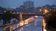 Flooding from torrential rain caused the closure of the Don Valley Parkway in Toronto on July 8, 2013. (Deborah Baic/The Globe and Mail)