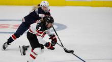 Jennifer Wakefield of Canada skates past Monique Lamoureux of the United States at the 2017 IIHF Womans World Championships. (Gregory Shamus/Getty Images)
