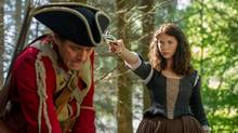 In Outlander, Caitriona Balfe gives an outstandingly natural performance as Claire Randall, right, a time-travelling British Army nurse. (Neil Davidson/© 2014 Sony Pictures Television)