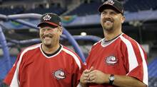 Team Canada manager Ernie Whitt, left, and coach Larry Walker laugh during a workout before their World Baseball Classic games in Toronto, March 6, 2009. (Reuters)