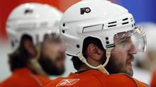 Philadelphia Flyers' Mike Richards looks on during hockey practice at the team's training facility in Voorhees, N.J., Thursday, May 27, 2010. The Flyers face the Chicago Blackhawks in Game 1 of the Stanley Cup Finals on Saturday, May 29 in Chicago. (AP Photo/Matt Rourke) (Matt Rourke)