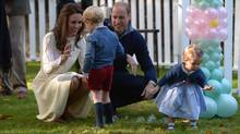 Prince William and his wife, Kate, take part in a tea party with their children Prince George and Princess Charlotte at Government House in Victoria on Sept. 29, 2016. (Jonathan Hayward/THE CANADIAN PRESS)