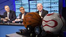 (L - R) CEO of BCE/Bell Canada George Cope, CEO of Rogers Communications Nadir Mohamed and Chairman of Maple Leaf Sports & Entertainment (MLSE) Larry Tanenbaum attend a news conference announcing the sale of MLSE in Toronto December 9, 2011. (MARK BLINCH/REUTERS)