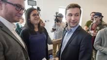 Gabriel Nadeau-Dubois, right, chats with supporters after announcing his candidacy earlier this month for the upcoming provincial by-election in the Montreal riding of Gouin. (Ryan Remiorz/THE CANADIAN PRESS)
