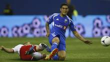 New York Red Bulls' defender Connor Lade (L) tackles Montreal Impact's forward Miguel Montano during the second half of their MLS soccer match in Montreal, May 19, 2012. (OLIVIER JEAN/Reuters)