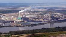 The Suncor mine facility along the Athabasca river as seen from a helicopter tour of the oil sands near Fort McMurray, Alta., Tuesday, July 10, 2012. (Jeff McIntosh/THE CANADIAN PRESS)