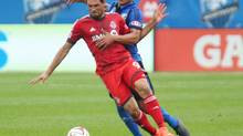 Toronto FC forward Gilberto and Montreal Impact defender Matteo Ferrari (Jean-Yves Ahern/USA Today Sports)