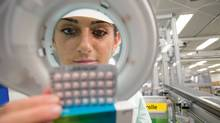 A Bayer Schering Pharma employee examines YAZ birth control pills in the company's factory in Berlin, Germany, in this undated handout photo, released to the media on Friday, Jan. 15, 2010. (Matthias Lindner/Via Bloomberg)
