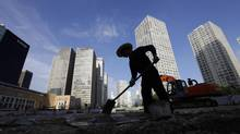 A labourer works at a construction site in Beijing's central business district on July 12, 2012. Peking University Economics professor Michael Pettis believes that the majority of real estate and infrastructure investment in China is unprofitable. (JASON LEE/REUTERS)