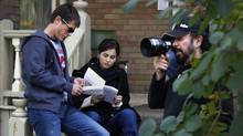 Actors Rob Lowe (left) and Camilla Belle go over lines as director Robert Lieberman (R) checks camera angles on the set of 'Breakaway' in Toronto on Oct. 15, 2010. (Moe Doiron/Moe Doiron/The Globe and Mail)
