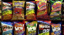 Bland corn chips were made tasty by covering them with a variety of chemicals to produce exciting flavours. (Daniel Acker/Bloomberg News)