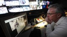Former coach and Senior Vice-President of Hockey Operations Mike Murphy, watches a replay of a hit under question in the National Hockey League video room (Deborah Baic/The Globe and Mail)