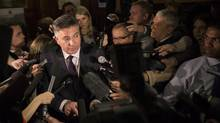 Ontario's Finance Minister Charles Sousa scrums with the media following question period at Queen's Park in Toronto on Tuesday, April 1, 2014. (Chris Young/THE CANADIAN PRESS)