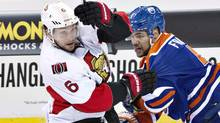 Ottawa Senators' Bobby Ryan (6) is checked by Edmonton Oilers' Mark Fraser (5) during second period NHL action in Edmonton, Alta., on Tuesday,  March 4, 2014. (The Canadian Press)