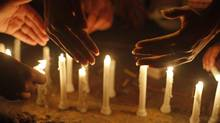 Women light candles while they take part in a rally to commemorate International Women's Day ahead a day in Karachi, March 7, 2014. On March 8 activists around the globe celebrate International Women's Day. (ATHAR HUSSAIN/REUTERS)