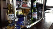 The world's top two beer makers agreed to join forces to create a company that would control nearly a third of the global market. AB InBev's brands include Budweiser, Stella Artois and Corona, while SABMiller produces Peroni and Grolsch. (Kirsty Wigglesworth/AP)