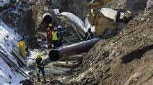 "The ""Line 9"" Enbridge oil pipeline is seen being worked on in East Don Parkland in Toronto, March 6, 2014. (MARK BLINCH/REUTERS)"