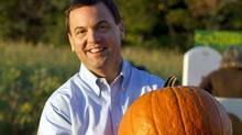 Ontario Progressive Conservative Leader Tim Hudak carries a pumpkin at a campaign stop in Vaughan on Oct. 4, 2011. (Frank Gunn/THE CANADIAN PRESS)