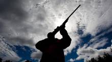 A rifle owner checks the sight of his rifle at a hunting camp property in rural Ontario west of Ottawa on Wednesday Sept. 15, 2010 (Sean Kilpatrick/THE CANADIAN PRESS)