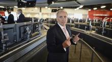 Air Canada president and CEO Calin Rovinescu speaks to media Tuesday at the opening of the airline's new global operations centre in Brampton, Ont. Mr. Rovinescu said Bombardier Inc.'s new C Series commercial jet is one option the airline is considering to replace its aging fleet of narrow-body aircraft. (Fred Lum/The Globe and Mail)