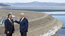 B.C. Premier Gordon Campbell, right, and Brad Bennett, grandson of W.A.C. Bennettt stand in front of the W.A.C. Bennett Dam in Hudson's Hope, B.C. Monday, April 19, 2010. Premier Campbell was in the area to announce the building of a new hydroelectric project named the Site C Clean Energy Project. Site C will use much of the same reservoir and will provide 900 megawatts of capacity and 4,600 gigawatt hours of electricity each year. (Jonathan Hayward/Jonathan Hayward/ The Canadian Press)