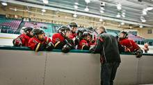 """Rob Anthony coach of the Leaside Flames """"Bantam A"""" hockey team, gives direction to his players during their game against the Markham Islanders (Jennifer Roberts for The Globe and Mail/Jennifer Roberts for The Globe and Mail)"""
