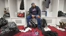 Montreal Alouettes' Nik Lewis sits in the team locker room as players clean out their lockers following the last game of the season on Nov. 6, 2016. (Graham Hughes/The Canadian Press)
