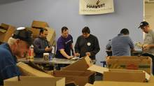 Volunteers sort food after checking the best before date at Winnipeg Harvest food bank. (Robert Tinker)