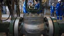 B.C. Premier Christy Clark during a tour of the Spectra natural gas facility in Fort Nelson, B.C., in May 2013. (John Lehmann/The Globe and Mail)