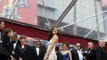 Marion Cotillard shows off her mermaid-cut gown on the red carpet at the 80th annual Academy Awards. The gown was printed with actual scales. (Lucas Jackson/Reuters)