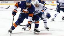 Nick Leddy #2 of the New York Islanders skates against Nikita Zaitsev #22 of the Toronto Maple Leafs during their game at the Barclays Center on October 30, 2016 in New York City. (Al Bello/Getty Images)