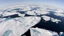 Ice floes float in Baffin Bay above the Arctic circle on July 10, 2008. (JONATHAN HAYWARD/THE CANADIAN PRESS)