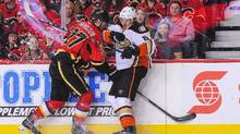 Dougie Hamilton of the Flames checks Rickard Rakell of the Anaheim Ducks in Game 3 of their playoff series in Calgary on Monday night. (Derek Leung/Getty Images)