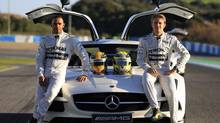 Mercedes Formula One racing driver Lewis Hamilton, left, of Britain and teammate Nico Rosberg of Germany pose for a publicity shot at the Jerez racetrack in southern Spain February 4, 2013. (Marcelo del Pozo/REUTERS)