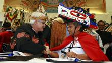 Former B.C. Premier Gordon Campbell shakes hands with Chief Alex Frank during a treaty signing ceremony in Tofino, B.C. November 13. (Jeff Vinnick/ The Globe and Mail/Jeff Vinnick/ The Globe and Mail)